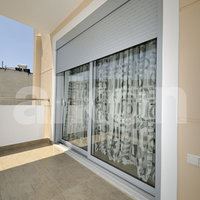 Two-leaf balcony sash door with mounted aluminium roller shutters